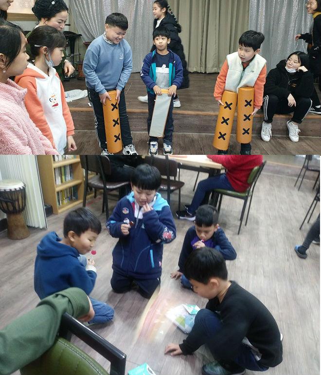 ▲ 딱지치기와 윷놀이 등으로 한국어와 한국 문화를 익히는 '콩콩이한글교실'의 아이들 모습