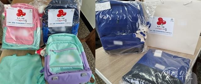▲ 성곡동 지역사회보장협의체에서 후원한 초등학생 책가방 세트